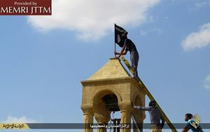 Chiese e simboli cristiani distrutti dall'Isis in Iraq. Foto Ansa.