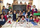 Due foto e bambini dai quattro continenti, con il futuro davanti: la campagna Benetton per l'integrazione